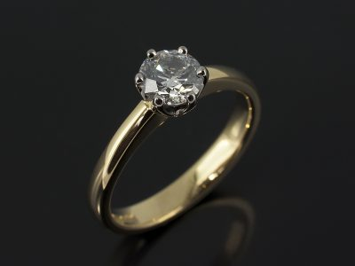 Round Brilliant 0.63ct D Colour SI1 Clarity EXEXEX in a 6 Claw White and Yellow Gold Solitaire Setting.