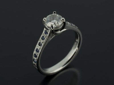 Platinum 4 Claw Design with Pavé Set Sapphire Shoulders Round Brilliant 0.64ct E SI1 EX Cut EX Polish EX Symmetry.