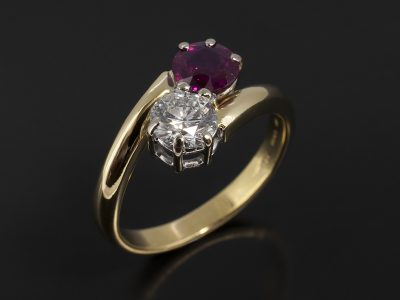 Round Brilliant 0.65ct E Colour VS1 Clarity and Round Brilliant 0.88ct Ruby in a 18kt White and Yellow Gold Claw Set Twist Design.