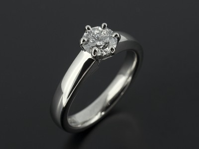 Round Brilliant 0.70ct D Colour SI1 Clarity Triple Excellent Grade in a 6 Claw Platinum Setting with Heavy Court Shaped Band.