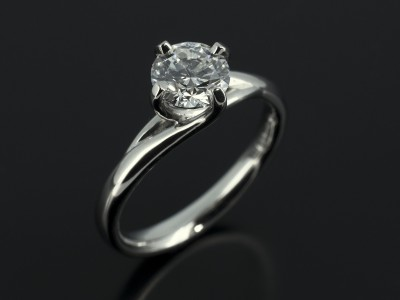 Round Brilliant 0.70ct E Colour SI1 Clarity in a Platinum 4 Claw Twist Compass Setting.
