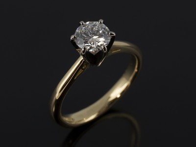 Round Brilliant 0.71ct E Colour VS2 Clarity EXEXEX in a 6 Claw 18kt Gold Solitaire Design with Scroll Shoulder Detail.