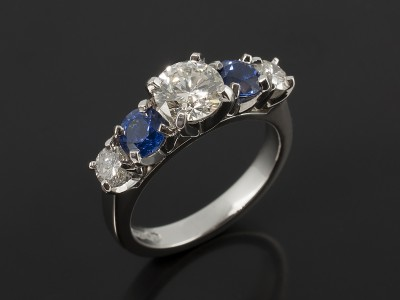 Round Brilliant Cut 0.73ct, 0.16ct and 0.15 with Round Brilliant Ceylon Sapphires 0.84ct Total in a Claw Set Platinum Design.