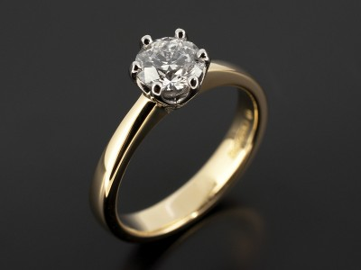 Round 0.74ct D Colour SI1 Clarity Triple Excellent Glade in a 6 Claw Platinum Setting with 18kt Yellow Gold Band.
