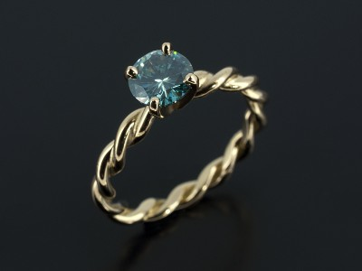Round Brilliant 0.88ct Blue Diamond in an 18kt Yellow Gold 4 Claw Setting with Rope Detail Band.