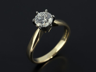Round Brilliant 0.90ct D Colour SI1 Clarity Triple Excellent Grade in a 6 Claw Platinum Setting with 18kt Yellow Gold Band.