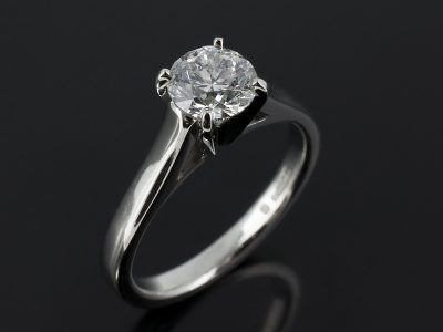 Round Brilliant 0.90ct D Colour SI1 Clarity in a Platinum 4 Claw Setting with Raised Gapped Shoulders.