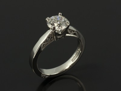 Round Brilliant Cut 0.90ct D Colour VS2 Clarity in a Platinum 4 Claw Design with Filigree Detail.