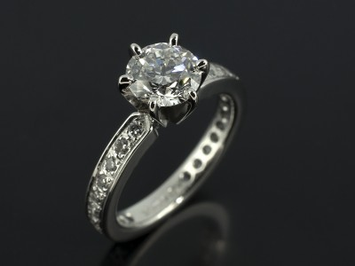 Round Brilliant 0.90ct E Colour SI2 Clarity in a Platinum 6 Claw Pavé Set Design.