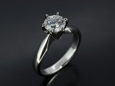Round Brilliant 0.90ct D Colour SI1 Clarity in a 6 Claw Platinum Solitaire Design.