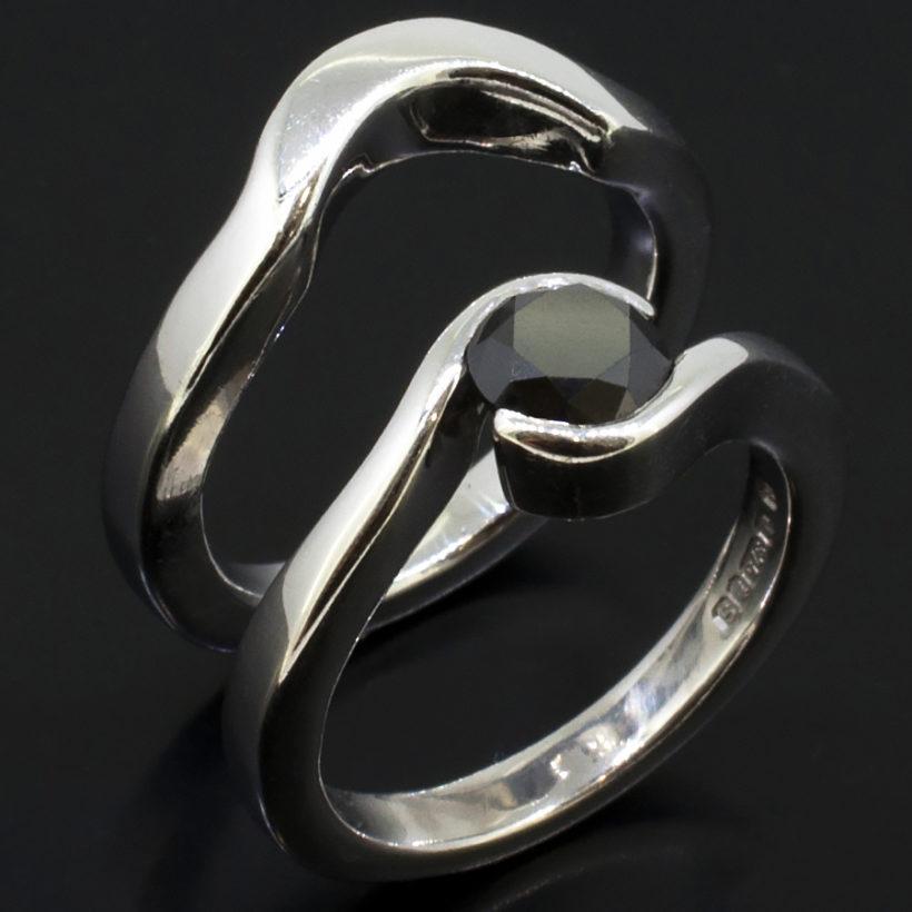 white gold engagement and wedding ring set, round black diamond twist set ring, tension set black diamond ring, white gold and black diamond ring, twist design bridal ring, 9kt white gold and black diamond ring