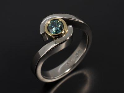 Round Brilliant Blue Diamond 0.33ct in an 18kt Yellow Gold and Palladium Rub Over Set Twist Design.