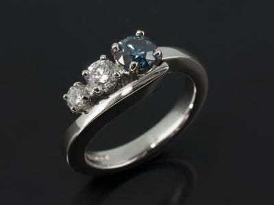 Round Brilliant Blue Diamond 0.53ct with 0.25ct and 0.10ct F VS Round Brilliant Diamonds in a Palladium Twist Design.