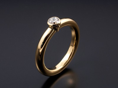 Round Brilliant 0.30ct F VS1 in an 18kt Yellow Gold Rub Over Setting with a Halo Band.