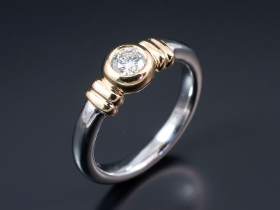Round Brilliant 0.35ct G Colour VVS2 Clarity in a Two Tone 18kt Gold Rub Over Contemporary Setting.