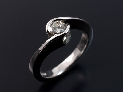 Round Brilliant 0.35ct H Colour VS2 Clarity in a Semi Tension Twist Platinum Setting with 2 x 0.15ct F VS Round Brilliant Diamonds Secret Set into Side of Setting.