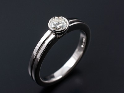 Round Brilliant 0.46ct H SI1 in an 18kt White Gold Rub Over Setting with Grooved Band.