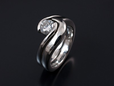 Round Brilliant 0.50ct E SI1 in Platinum Twist Setting with Fitted Wedding Ring