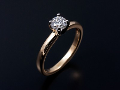 Round Brilliant 0.51ct F SI1 in a 4 Claw Platinum Setting with 18kt Yellow Gold Band.