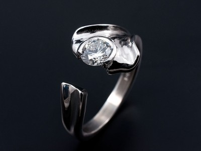 Round Brilliant 0.60ct E Colour SI1 Clarity in a Leaf Inspired Semi Rub Over Setting.