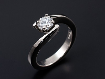 Round Brilliant 0.64ct D Colour SI1 Clarity EX Proportions, Polish and Symmetry Set in a 4 Claw Palladium Twist Setting.
