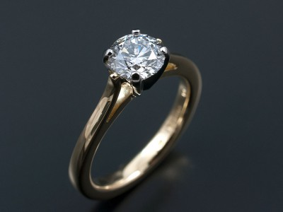 Round Brilliant 0.78ct E VS2 Excellent Proportions, Symmetry and Polish in a 4 Claw Platinum and 18kt Yellow Gold Setting.