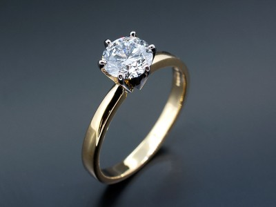 Round Brilliant 0.90ct D Colour SI1 Clarity Triple Excellent Grade in an 18kt White and Yellow Gold 6 Claw Setting