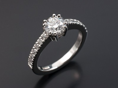 Round Brilliant 0.90ct D SI1 in an 8 Claw Platinum Setting with Round Brilliant Diamonds Claw Set into Band