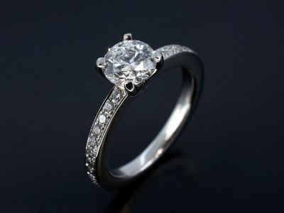 Round Brilliant 0.91ct D Colour SI2 Clarity Triple Excellent Grade in a Hand Made 4 Claw Platinum Setting with Pave Set Shoulders.