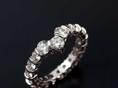 Round Brilliant 18 x 0.10ct F VS and 3 x 0.20ct F VS Diamonds Hand Made in a Platinum Bar Set Ring.