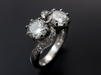 Round Brilliant 2 x 1.02ct G SI2 in a Platinum Twist Design with Pave Set Shoulders.