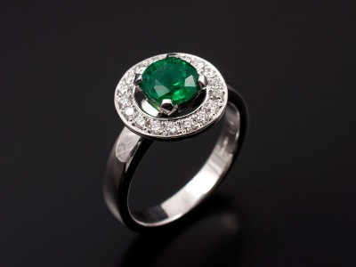 Round Brilliant Cut Emerald 0.83ct with Pave Set Diamond Halo in 18kt White Gold