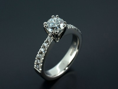 Round Brilliant E Colour SI2 Clarity in a Double Claw Setting with Claw Set Diamond Shoulders. Hand Made in Palladium.