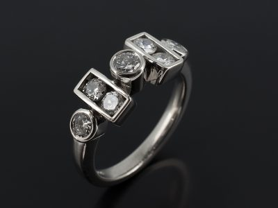 Round Brilliant Cut Diamonds 0.80ct Total in a Contemporary Rub Over Set Palladium Design.
