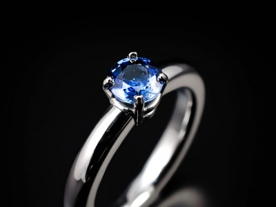 Round Ceylonese Sapphire 0.72ct Hand Made in a Platinum Setting and Halo Shaped Band