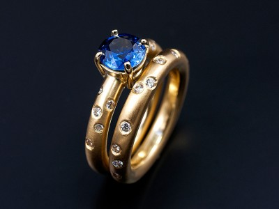 Round Ceylonese Sapphire 1.17ct in an 18kt Yellow Gold Setting with Scattered Secret Set Diamonds with a Matching Wedding Ring Copy