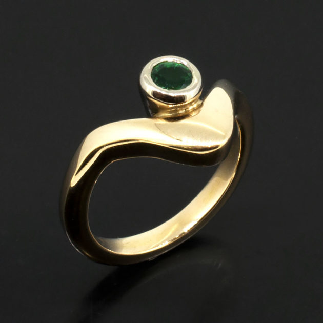 Round Emerald 0.10ct in an 18kt White and Rose Gold Rub Over Set Wave Design, wave design gold ring, white gold rub over emerald ring, white and yellow gold wave design ring, round emerald rub over ring