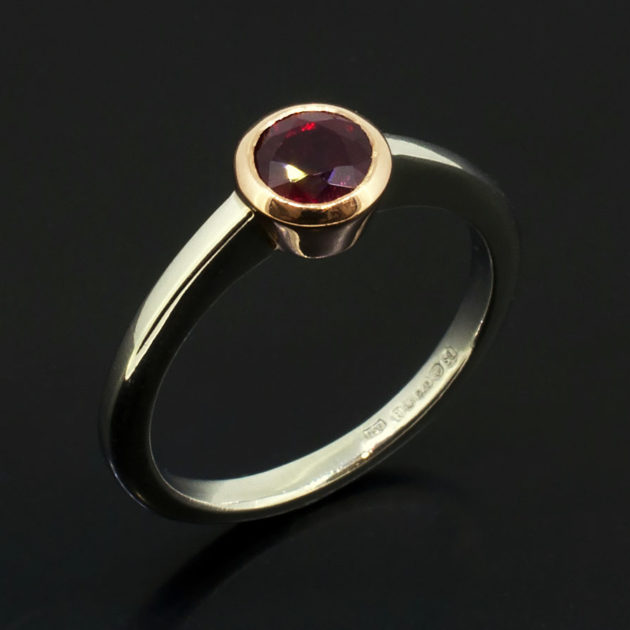 Round Brilliant Cut Pigeon Blood Ruby, Platinum Ring with Rose Gold Rubover Setting