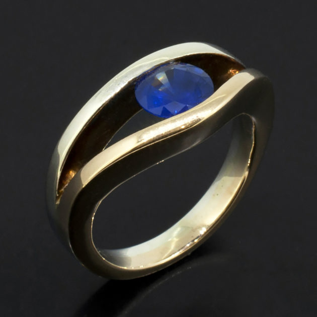 Round Sapphire 1.05ct in a Tension Set 9kt White and Yellow Gold Design, white and yellow gold split shank ring, 1.05ct round sapphire tension set ring, sapphire ring designed and made in scotland