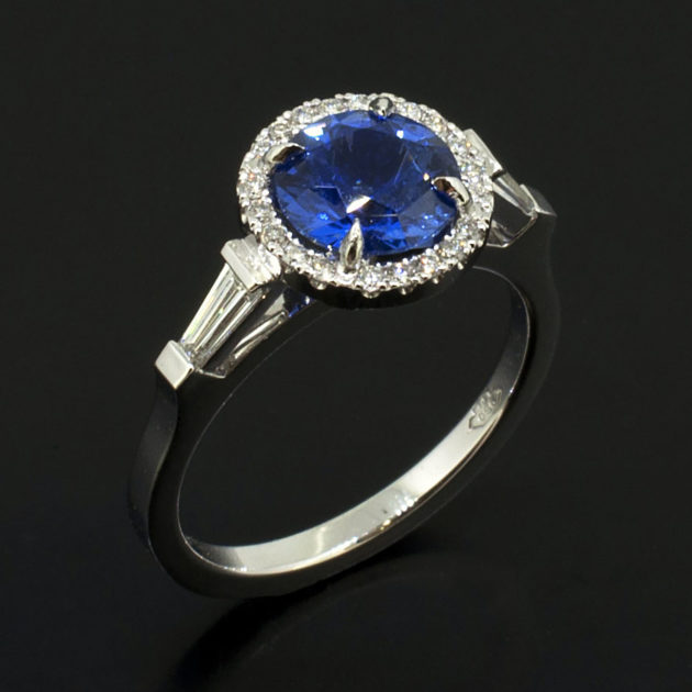 Sapphire ring with tapered diamond shoulders, art deco style sapphire and diamond ring, vintage style platinum ring with sapphire and diamonds, brilliant round cut sapphire halo ring, baguette cut diamond shoulder set ring