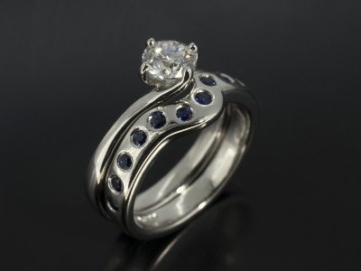 Round Sapphire Secret Set Fitted Platinum Wedding Ring.
