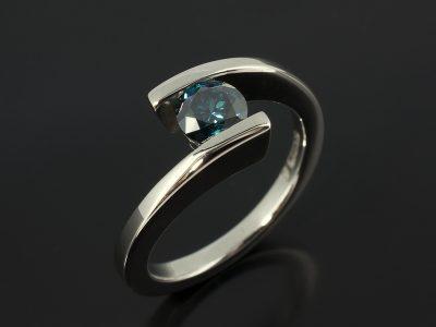 Round Brilliant Blue Diamond 0.56ct in a Palladium Tension Set Twist Design.