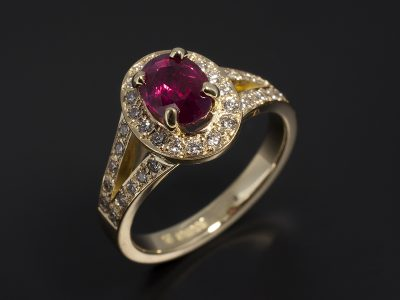 Oval Cut Ruby Oval 1.08ct in an18kt Yellow Gold Diamond Pavé Set Halo and Split Band Design.