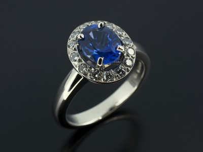 Oval Ceylonese Sapphire 1.42ct in a Platinum Cluster Setting.
