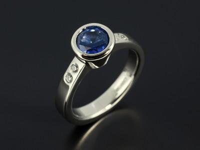 Round Sapphire1.06ct in a Palladium Rub Over Setting with Secret Set Side Diamonds.