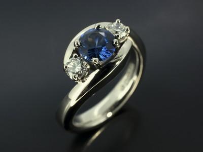 Palladium Trilogy Twist Design with Round Ceylonese Sapphire 0.90ct and Round Brilliant Cut Diamonds 0.30ct Total