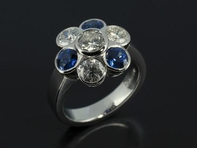 Sapphire and Diamond Flower Cluster Design in Platinum Rub Over Settings.