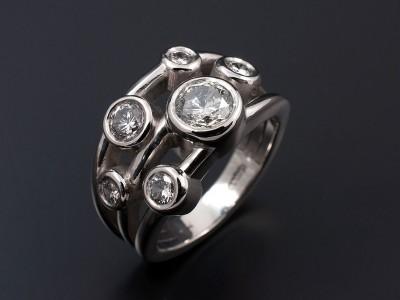 Satellite Design with Multiple Round Brilliant Diamonds in Palladium with Rub Over Settings.