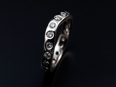 Secret set shaped hand made platinum eternity ring comprising 20 x 0.04ct FVS round brilliant diamonds