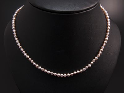 Peach Round Freshwater Pearl Necklace With A Silver Magnetic Clasp. Available In Store £360.00